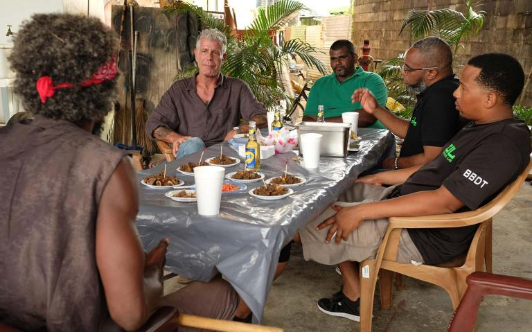Anthony Bourdain in Couva eating after a stick fighting match. Photo courtesy of David S. Holloway and CNN.